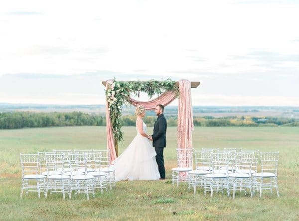 wedding in sylvan lake with cedar arch and sequins