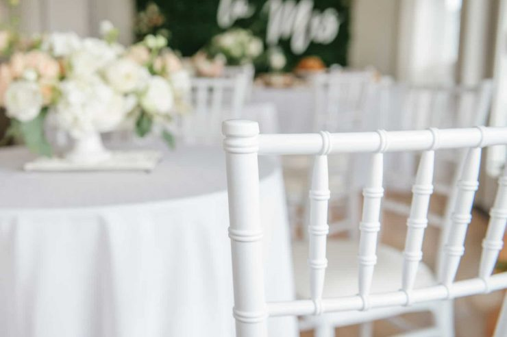 white chiavari chair at white cocktail table