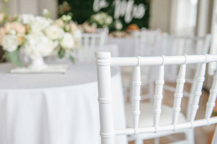 white chiavari chair at white cocktail table